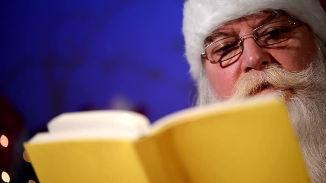 Reading Christmas story Reading Christmas story christmas stocking stock videos & royalty-free footage