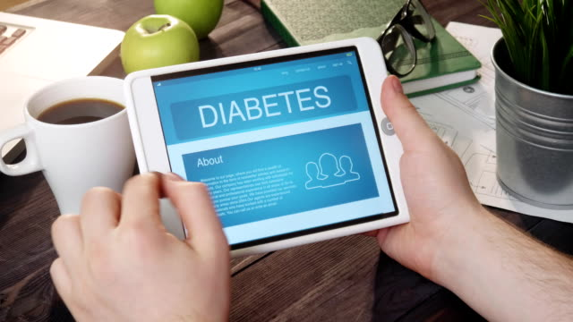 reading diabetes internet page using digital tablet - diabetes стоковые видео и кадры b-roll
