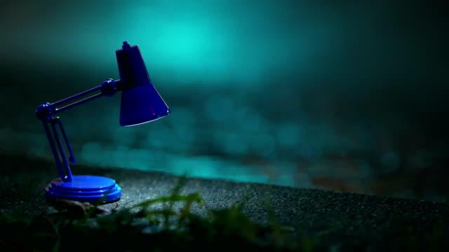 Reading lamp on sidewalk, traffic lights, night