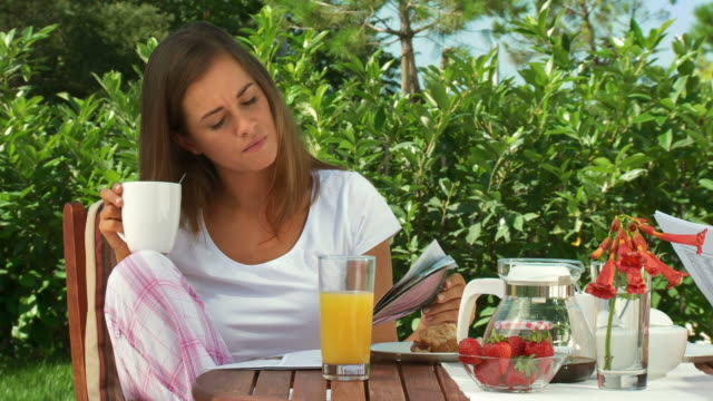 HD DOLLY: Reading Magazine After Breakfast video