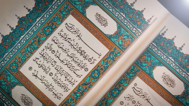Reading Quran, Close up of Noble Quran. video