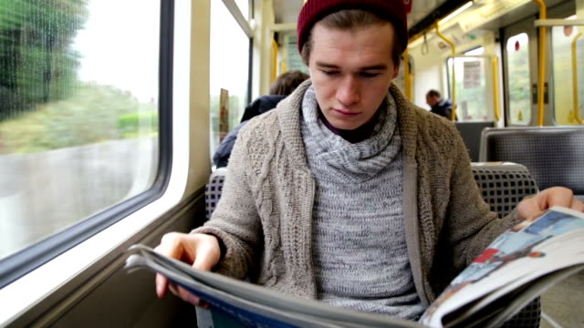 Reading the Paper on the Train video