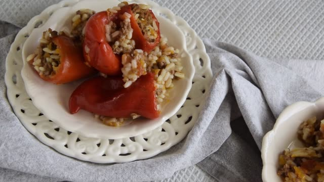 Ready for eat stuffed red peppers with minced meat, rice and vegetables Ready for eat stuffed red peppers with minced meat, rice and vegetables stuffed stock videos & royalty-free footage