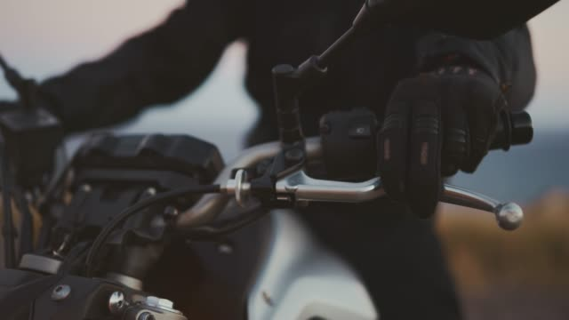 Ready for speed Detail shot of motorcycle rider's hands on handlebars, motorcycle adventure lifestyle handlebar stock videos & royalty-free footage