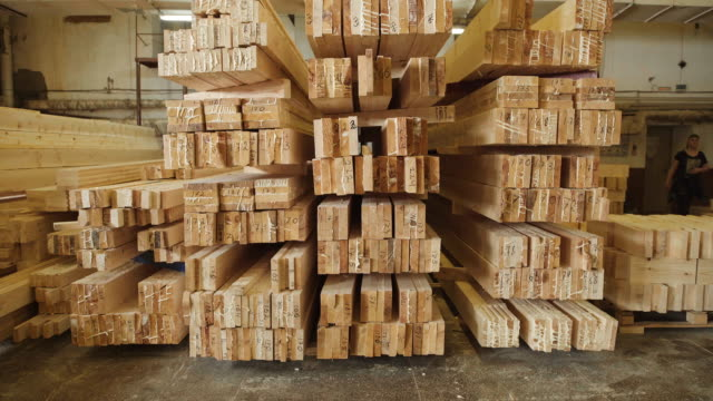Ready glulam folded neatly in a pile. Manufacture of wood glued beams video