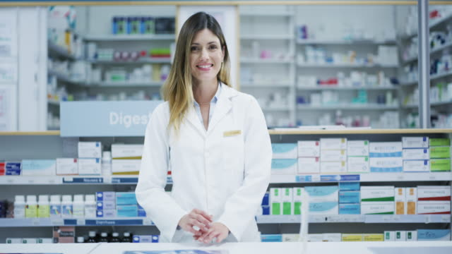Ready to make you feel better 4k footage of a pharmacist working in a chemist pharmaceutical industry stock videos & royalty-free footage