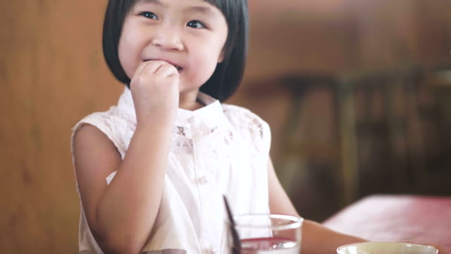 Real Asian Daughter Eatting Real Asian Daughter Eatting rice cereal plant stock videos & royalty-free footage
