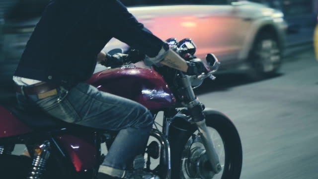 Real Bangkok View : Man driving a motorcycle at night