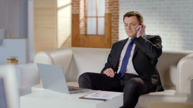 Real estate broker calling client, starting phone conversation video
