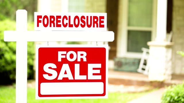real estate for sale, foreclosure sign in front of house. - foreclosure stock videos & royalty-free footage