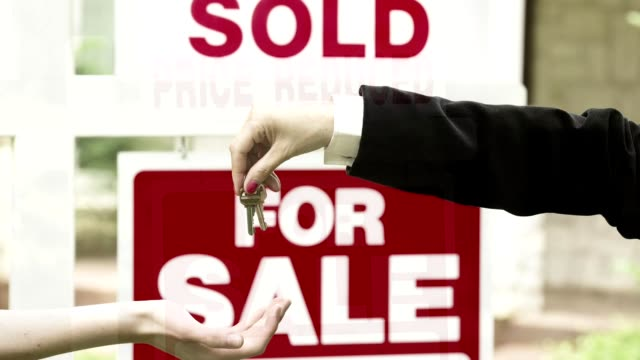 real estate for sale sign in front of house. - foreclosure stock videos & royalty-free footage