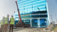 istock Real Estate Project Construction Site with Architectural Engineer, Investor and Worker Finish Industrial Building Development by Using 3D VFX Graphics. Futuristic Concept of Buildings Development 1273352492