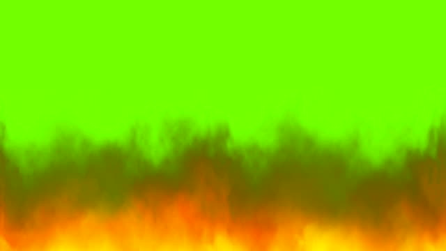 real fire flames on chroma key, green screen background - fiamma video stock e b–roll