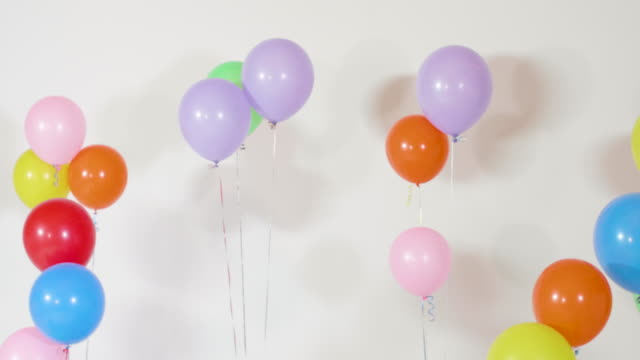 real helium balloons floating white isolated background - birthday stock videos and b-roll footage