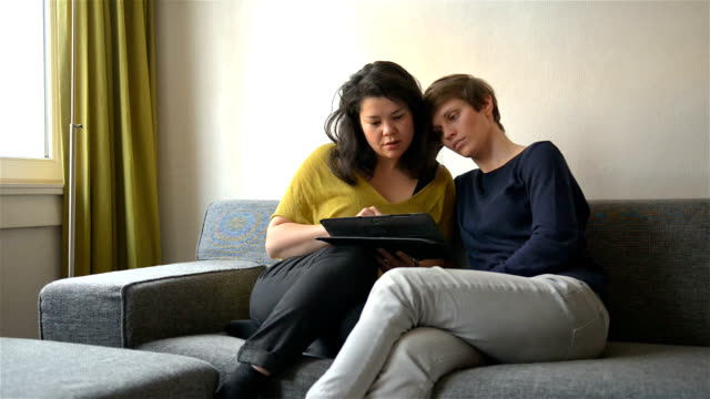 DOLLY: Real life lesbian couple using tablet computer together video