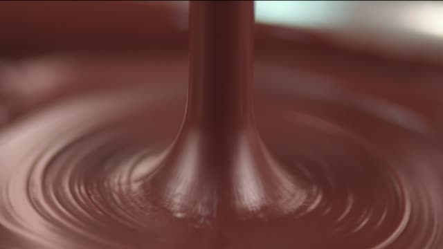 real liquid chocolate - cioccolato video stock e b–roll