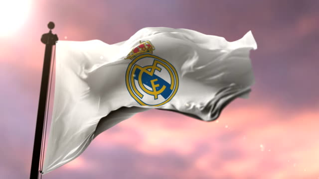 real madrid football club flag waving at sunset, loop - логотип стоковые видео и кадры b-roll