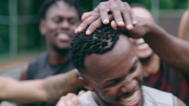 Real teammates love you like a brother 4k video footage of a group of young men congratulating their teammate during a game of basketball athleticism stock videos & royalty-free footage