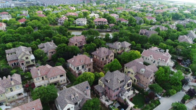 Real time Aerial view of detached duplex houses video