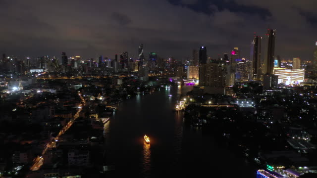 Real time of Chao Phraya River with Bangkok cityscape aerial view