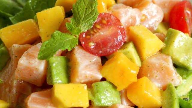 4K Real time Sauce Pours On Salad Mango Salad Dish.