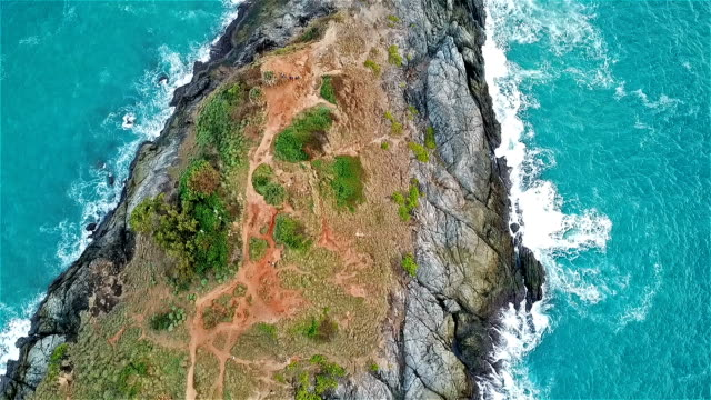 Real time shot of sea surf. Aerial top down view at cape Panwa ,Phuket