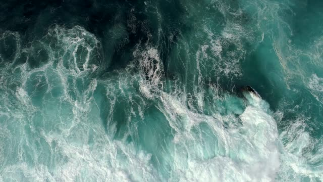 Real time shot of sea surf. Aerial top down view video