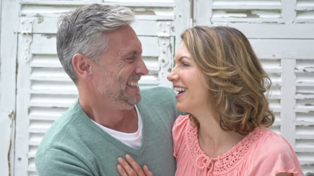 Real time video of a happy mature caucasian couple at home video