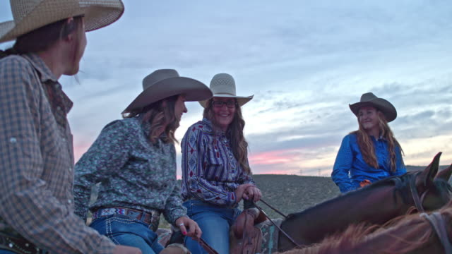 Real time video of cowgirls talking and having fun enjoying horseback riding in the fields at dusk Real time video of cowgirls talking and having fun enjoying horseback riding in the fields at dusk. horseback riding stock videos & royalty-free footage