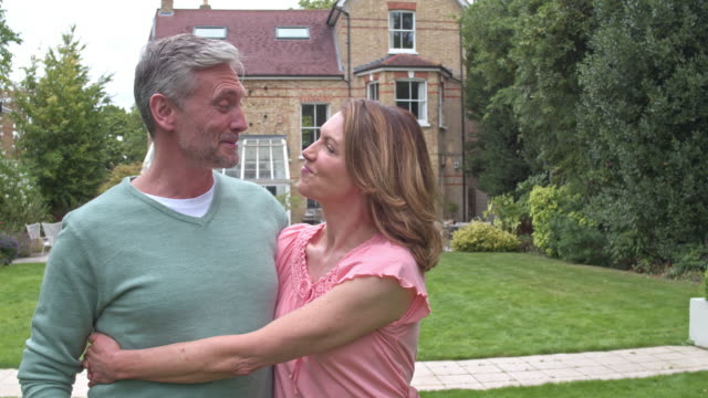 Real time video of mature couple in the new backyard house. Real time video of mature couple in the new backyard house. 50 54 years stock videos & royalty-free footage