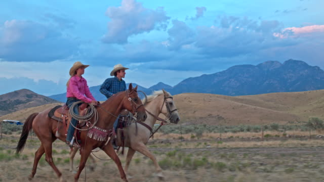 Real time video of two friends horseback riding at dusk in Utah. Real time video of two friends horseback riding at dusk in Utah. cowgirl stock videos & royalty-free footage