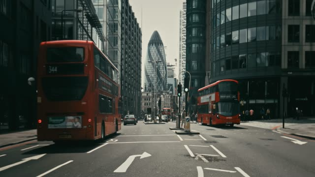 real time video of vehicles moving on street against 30 st mary axe - london architecture stock videos & royalty-free footage