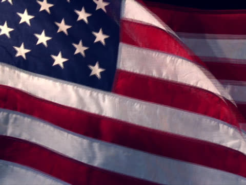 Real US American Flag 02 Real US American flag blowing in a breezy wind (more wavy). circa 4th century stock videos & royalty-free footage