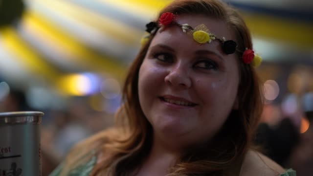 real woman celebrating at oktoberfest - portrait - costume tradizionale video stock e b–roll