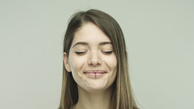 Real woman smiling with her eyes closed video