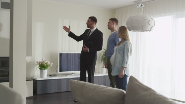 Real-estate Agent Shows New Apartments to Couple. Woman is Pregnant. video