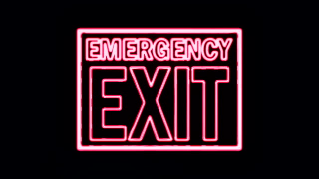 Realistic Emergency Exit Neon Sign Lighting Up video