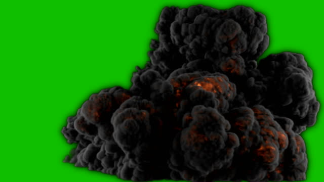 realistic giant explosion and black smoke in front of a green screen. vfx element. - взрывающийся стоковые видео и кадры b-roll