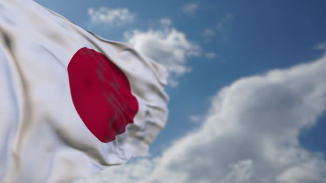 realistic japanese flag is waving slowly. - bandiera nazionale video stock e b–roll