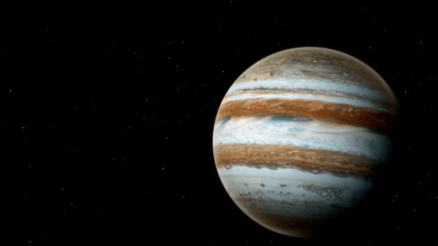 realistic planet jupiter with europa from deep space - io księżyc filmów i materiałów b-roll
