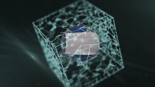realistische schützende medizinische gesichtsmaske über demplaneten in transluzenter würfelform über dunklem hintergrund. - woman and polygon stock-videos und b-roll-filmmaterial
