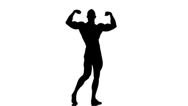 실감나는 실루엣 끼칠 bodybuilders 흰색 - 보디 빌딩 스톡 비디오 및 b-롤 화면