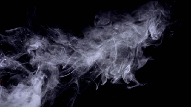 realistic smoke, fog, haze isolated on black background, screen mode for blending overlay effect. slow motion 4k shot. - d'atmosfera video stock e b–roll
