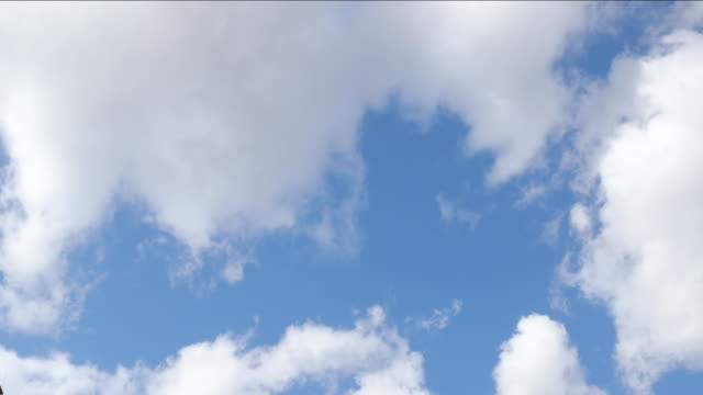 Really fast moving clouds on nice blue sky captured during day.