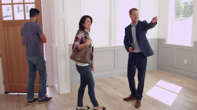 Realtor Showing Couple Around New Home Shot On R3D video