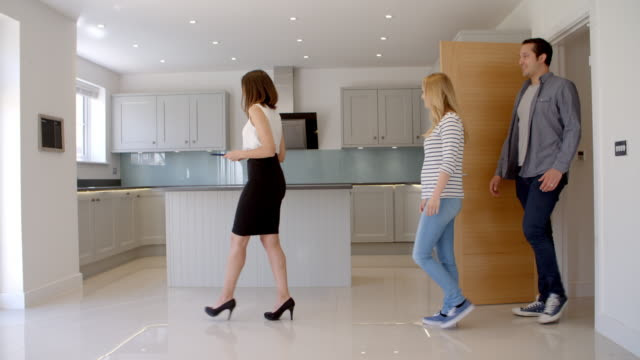 Realtor Showing Couple Around Property For Sale video