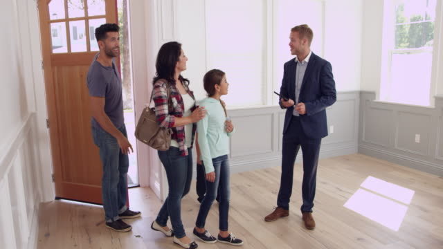 Realtor Showing Family Around New Home Shot On R3D video
