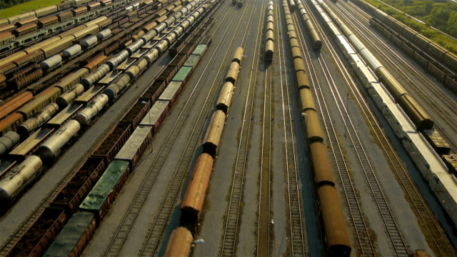 Rear Aerial view of freight train depot video