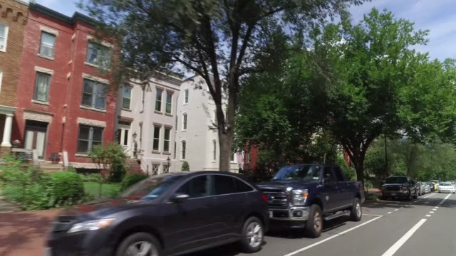 Rear Profile View of Typical Residential Homes on Capitol Hill A rear profile driving perspective past typical Capitol Hill residences in Washington DC. district stock videos & royalty-free footage