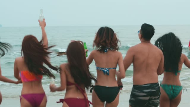 Rear View : Friends Together on the beach